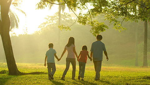A young family walking i a park